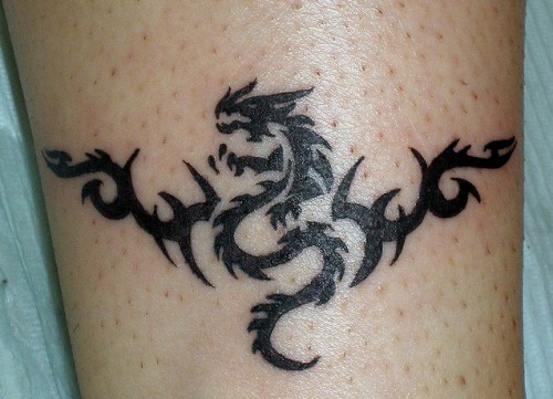 Tribal Dragon Tattoo on Ankle