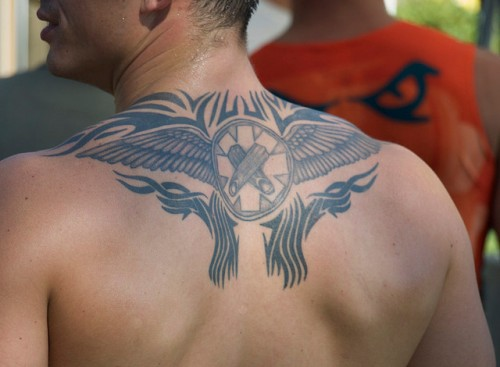 Tribal Wings and Crossed Fingers Tattoo
